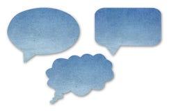 Spracheblasen des blauen Papiers stellten auf lokalisiertes Weiß ein Stockfotos