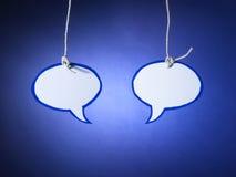 Spracheblasengesprächspaare - Archivbild Stockfotografie