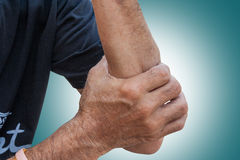 The Sprain. Muscles tension on old man hand in background. Sprain. Muscles tension on old man hand in background stock photo