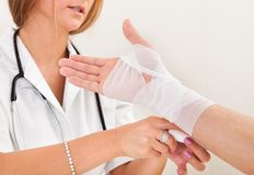 Sprained right hand treated Stock Images