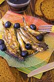 Sprat and bread Royalty Free Stock Images