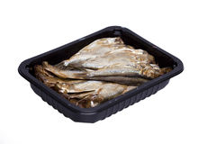 Sprat fish in black pot Stock Image