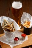 Sprat and french fries with gravy Stock Photo