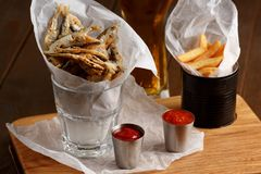 Sprat and french fries with gravy Stock Image