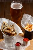Sprat and french fries with gravy Royalty Free Stock Images