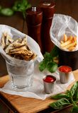 Sprat and french fries with gravy Royalty Free Stock Photo