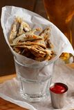 Sprat with gravy and glass of beer Royalty Free Stock Photo