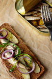 Sprat sandwich with pickled vegetables Royalty Free Stock Photo
