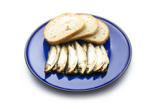 Sprats. Smoked sprats with bread isolated on white background Stock Photography