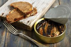 Sprats and black bread. Stock Photo