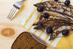 Sprats and bread on a plate Stock Photo