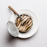 Sprats in can and fork Stock Photos