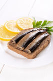 Sprats sandwich and lemon slices Stock Images