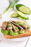 Sprats sandwich on white plate Stock Photos