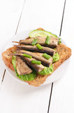 Sprats sandwich on white plate Royalty Free Stock Photography