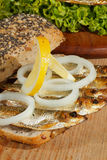 Sprats, smoked, salad, lemon, onions, whole wheat bread Royalty Free Stock Photo