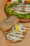 Sprats, smoked, salad, lemon, onions, whole wheat bread Stock Images