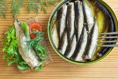 Sprats and tomatoes on a table Stock Images