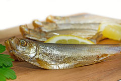 Sprats on a wooden board Stock Photo