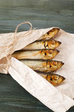 Sprats wrapped in white paper Stock Photography