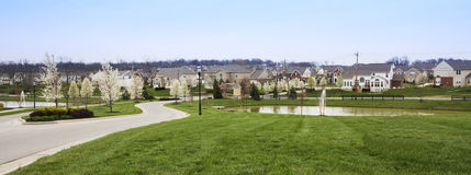 Sprawling American Residential Subdivision. Panorama of a Sprawling American Residential Subdivision between Blue Sky and Green Grass royalty free stock photos