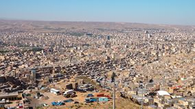Sprawling city of Tabriz, Iran. Birds eye view showing the sprawling city of Tabriz in Iran. Shanty towns sit on the outskirts of the city, with new developments stock footage