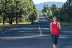 Sprawność fizyczna Nad Czterdzieści kobiet bieg Zdjęcia Stock