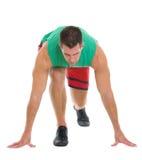 Sprawności fizycznej biegacz w przygotowywający początek pozycja Obrazy Royalty Free