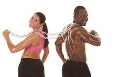 Sprawności fizycznej pary z powrotem łańcuchu patrzeć Obrazy Stock
