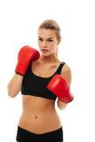 Sprawności fizycznych zdrowe kobiety boksuje w studiu odizolowywającym Fotografia Stock