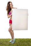 Sprawności fizycznej kobiety mienia pustego papieru wielki znak Obraz Stock