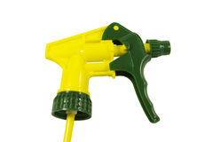 Spray. Yellow spray with a green tip - a nozzle on a bottle. On a white background Royalty Free Stock Photo