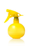 Spray Bottle. Yellow spray bottle with some water/detergent in it. Isolated on white background with a natural reflection under it Royalty Free Stock Images