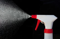 Spray Bottle in Action stock image