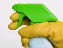 Spray bottle cleaner. Rubber glove and spray bottle for cleaning royalty free stock photography