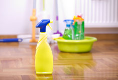 Spray bottle for cleaning on the floor Stock Photo