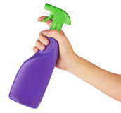 Spray bottle in hand Stock Photo