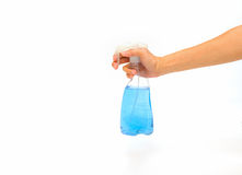 Spray bottle by hand. Stock Image