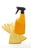 Spray bottle and protective gloves Royalty Free Stock Photography