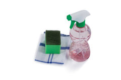 Spray bottle, scouring pad and napkin cloth on white background Royalty Free Stock Photos