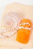 Spray bottle sunscreen, towel, shells Stock Photo