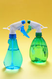 Spray Bottles. On Yellow Background Royalty Free Stock Images