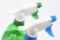 Spray Bottles. Drop out on white background stock photo