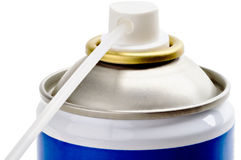Spray can nozzle extension. Blue spray can with white plastic extension isolated on white Royalty Free Stock Image