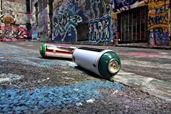 Spray cans in a Graffiti Alley in Melbourne stock images
