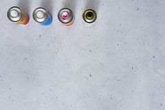 Spray cans graphically on concrete Stock Photo