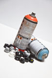 Spray cans and mask Stock Photo