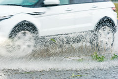 Spray from the car Stock Photos