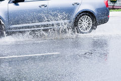 Spray from the car Stock Photo