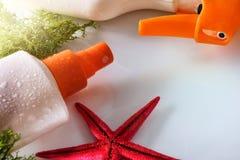Spray des Lichtschutzes zwei mit Starfish erhöhtem Ansichtabschluß oben Stockfotografie